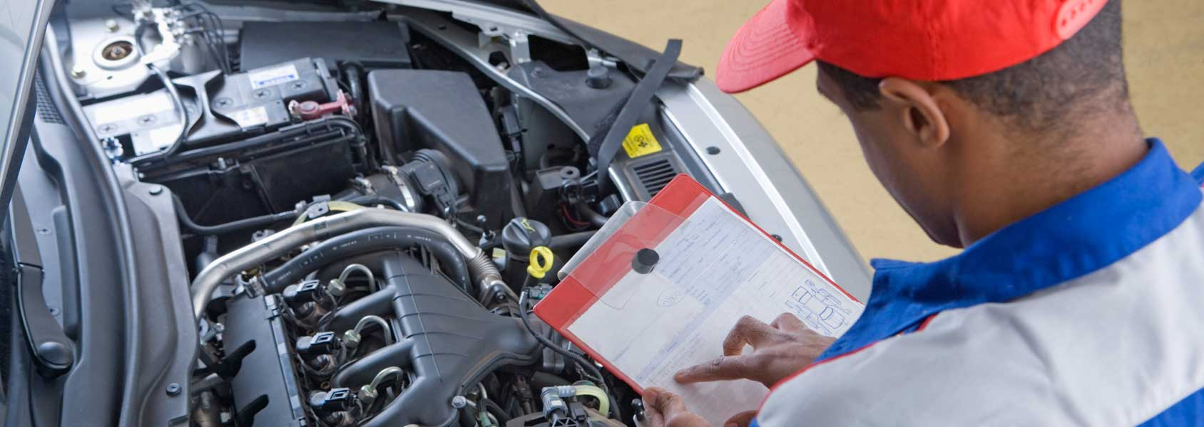 mechanic checking engine